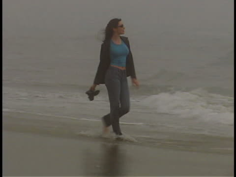 walking in the surf - cardigan sweater stock videos & royalty-free footage