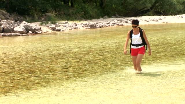 hd: walking in the water - walking in water stock videos & royalty-free footage