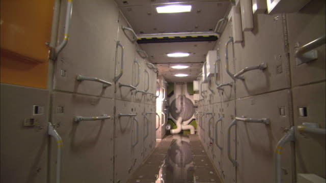 WS POV Walking inside mockup of International Space Station, approaching pressure lock, Houston, Texas, USA