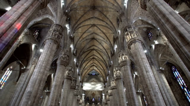 walking inside the milan cathedral - gothic style stock videos & royalty-free footage