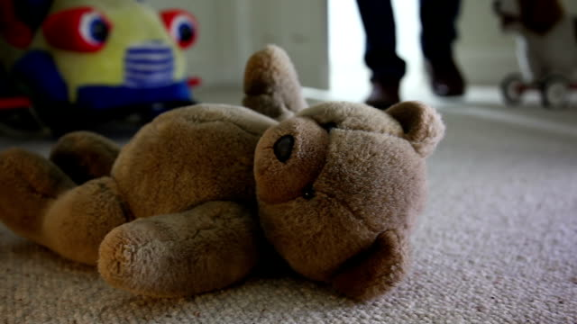 walking into a child's bedroom at night, toys on floor. - teddy bear stock videos and b-roll footage