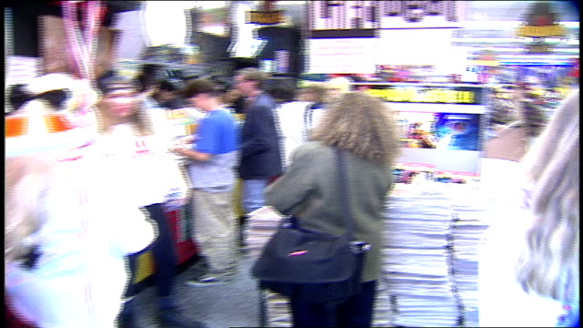 pov of walking into a crowded tower records in los angeles california - tower records stock videos & royalty-free footage