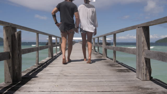 walking into a day of bliss together - pier stock videos & royalty-free footage