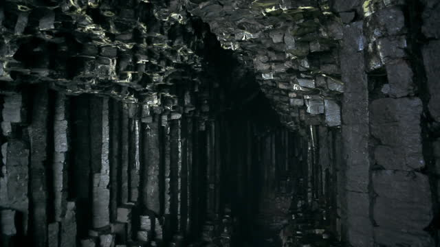 pov walking into fingal's cave on isle of staffa, scotland - rock formation stock videos & royalty-free footage