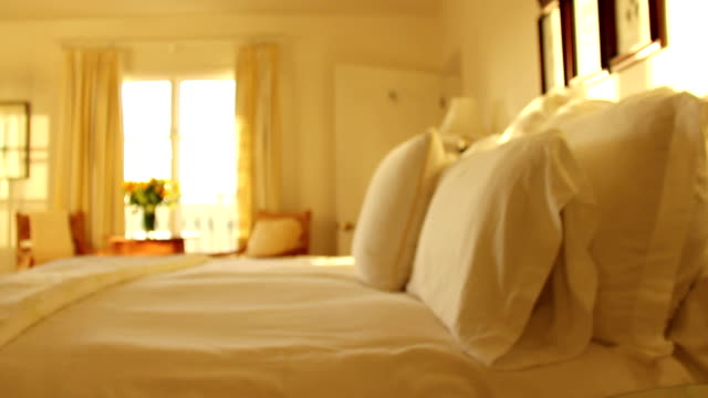 walking into sunny bed and breakfast bedroom - hotel stock videos & royalty-free footage