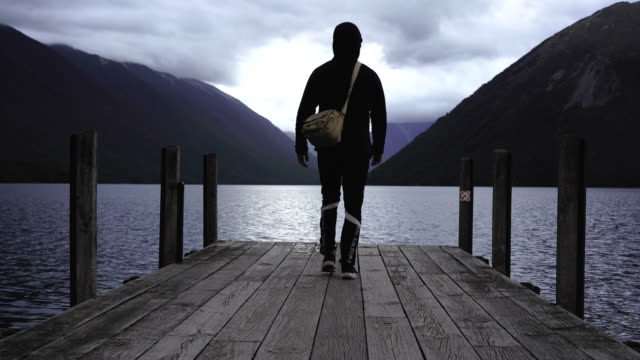 walking into wilderness. - māori people stock videos & royalty-free footage