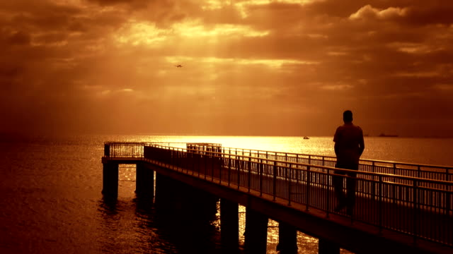 walking man over the pier - the end stock videos & royalty-free footage
