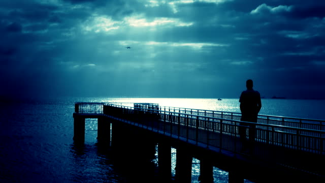walking man over the pier (blue) - solitude stock videos & royalty-free footage