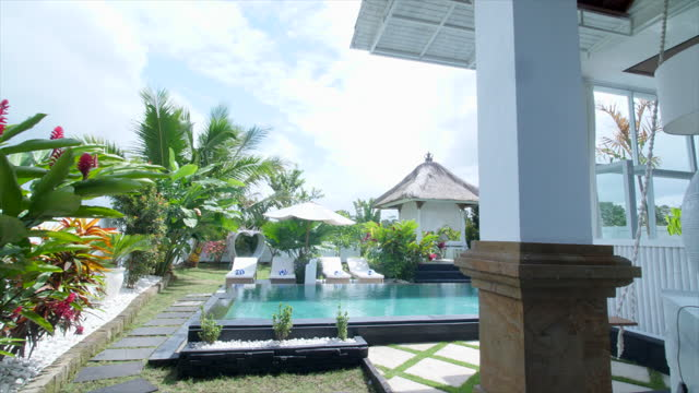 pov walking near pool at a villa resort hotel traveling in exotic tropical bali, indonesia. - slow motion - hotel stock videos & royalty-free footage