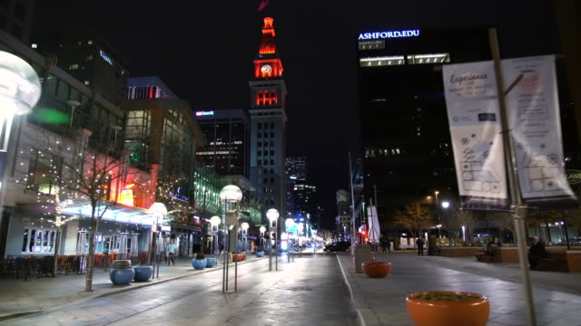 ws pov walking on 16th st mall at night / denver, co, usa - clock tower stock videos & royalty-free footage