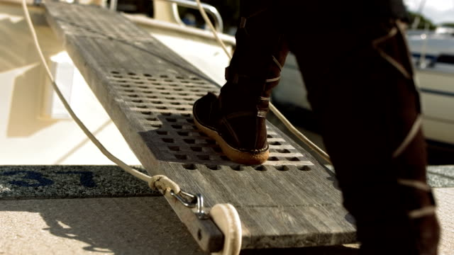 hd: walking on a boat boarding ladder - human leg stock videos & royalty-free footage