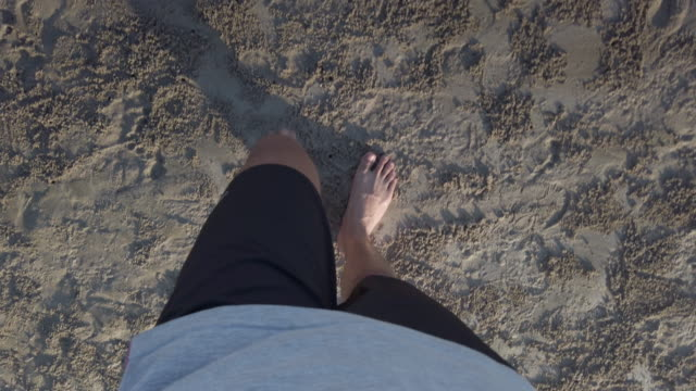 4k walking on a sandy beach - footprint stock videos and b-roll footage