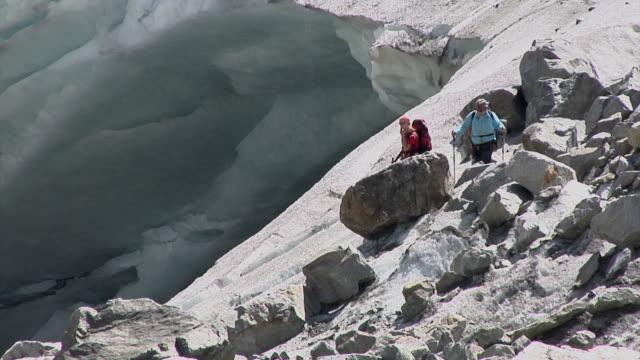 walking on a swiss glacier - kletterausrüstung stock-videos und b-roll-filmmaterial
