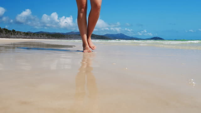 walking on an idillic beach feet. - low angle view stock videos & royalty-free footage