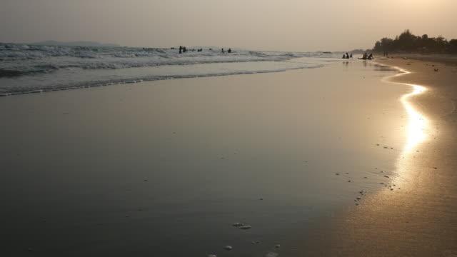 walking on beach at sunset - walking in water stock videos & royalty-free footage