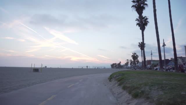 pov, walking on beach foot path in venice, california - venice beach stock videos & royalty-free footage