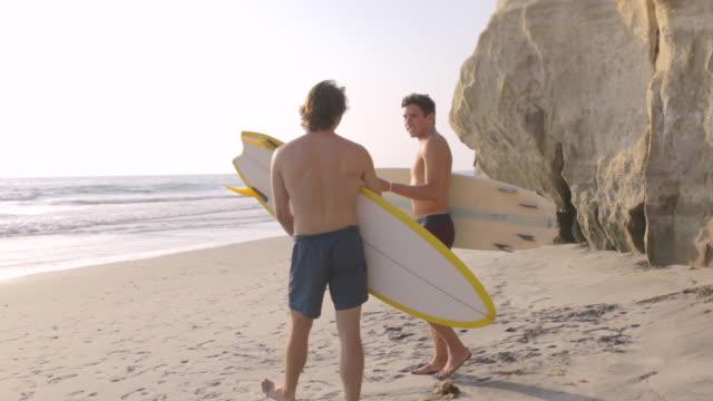 walking on beach - badeshorts stock-videos und b-roll-filmmaterial