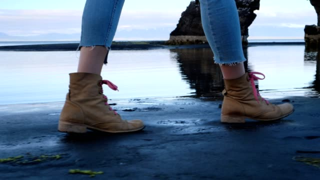walking on black sand. close up on shoes - geology stock videos & royalty-free footage