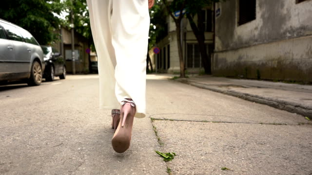 walking on city street slow motion - human foot stock videos & royalty-free footage