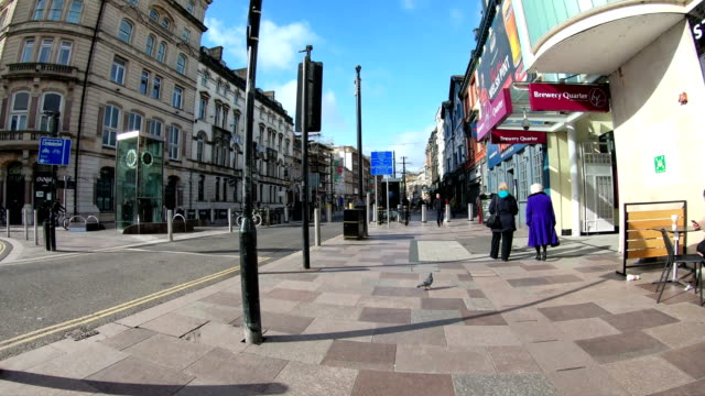 walking on city streets of cardiff time lapse - high street stock videos & royalty-free footage