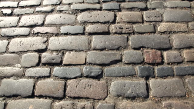 walking on cobbles - kopfsteinpflaster stock-videos und b-roll-filmmaterial