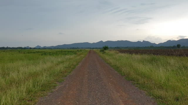 walking on dirt road. - horizon over land stock videos & royalty-free footage