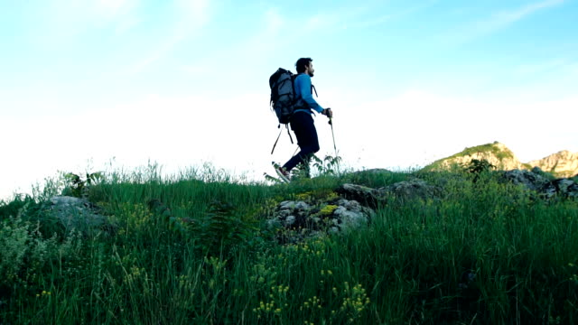 walking on mountain - hiking pole stock videos and b-roll footage