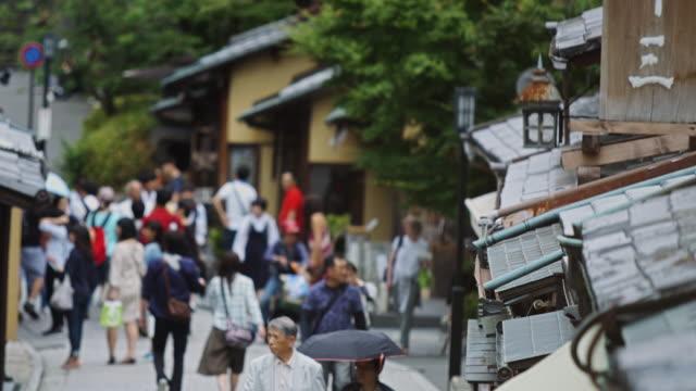 walking on ninen-zaka, kyoto - steep hill stock videos & royalty-free footage