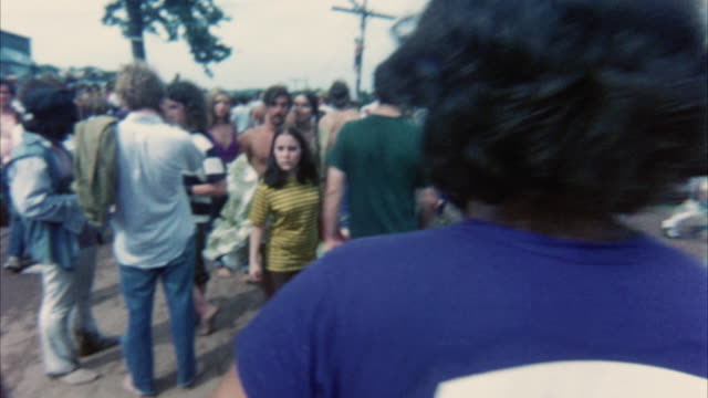 pov walking on road at woodstock festival / bethel, new york, usa - anno 1969 video stock e b–roll