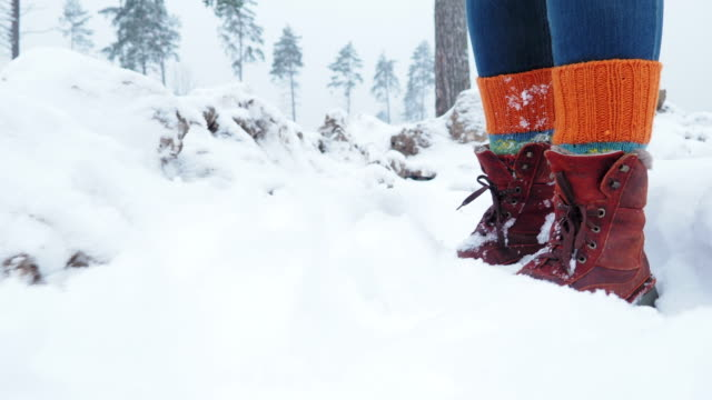 walking on snow in forest - leg warmers stock videos & royalty-free footage
