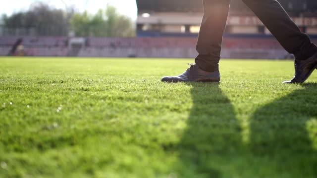 walking on soccer field grass - soccer field stock videos & royalty-free footage