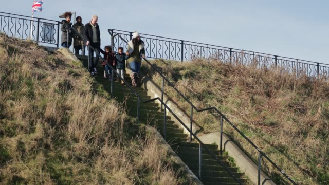 walking on the beach - whitley bay stock videos & royalty-free footage