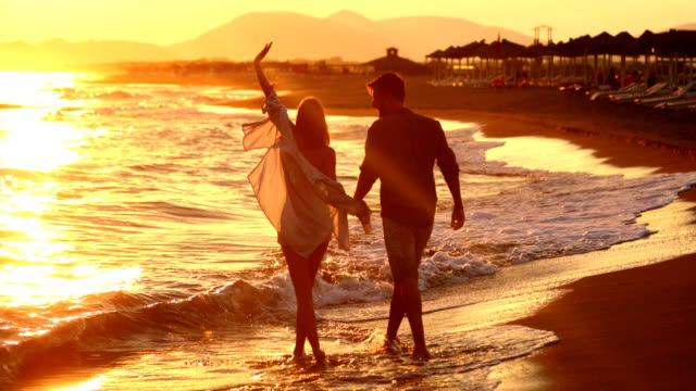 walking on the beach. - couple relationship stock videos & royalty-free footage
