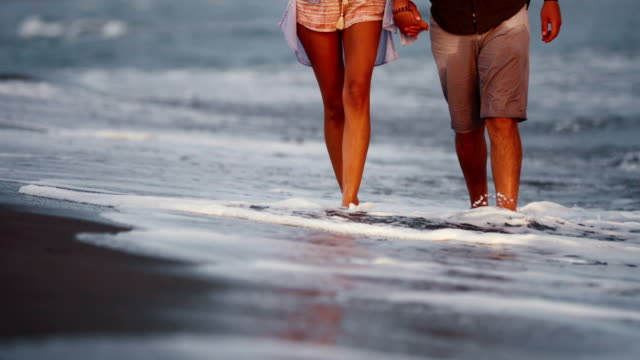 walking on the beach. - romantic activity stock videos & royalty-free footage