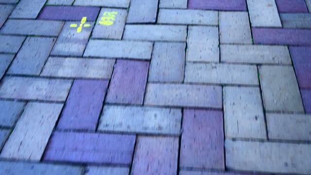 walking on the brick walkway, street, brick pavement in perspective - surface level stock videos & royalty-free footage