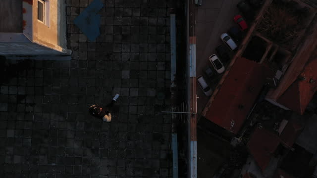walking on the rooftop - housing difficulties stock videos & royalty-free footage