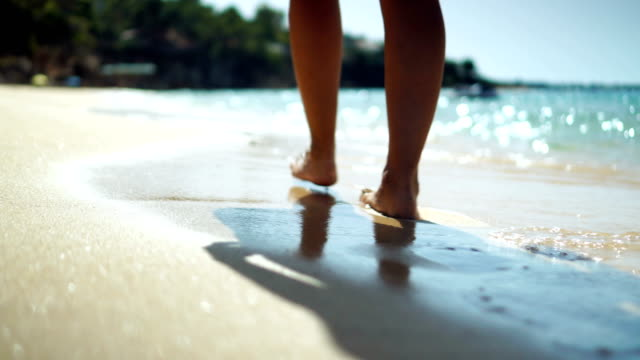 walking on the sandy beach - clima tropicale video stock e b–roll