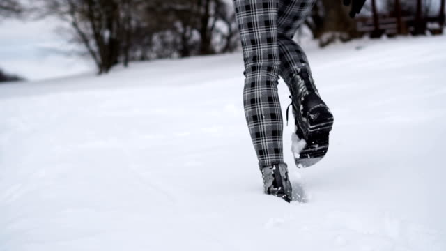 walking on the snow- slow mo - human leg stock videos & royalty-free footage