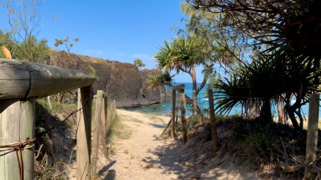walking on to dreamtime beach at fingal head australia - tide stock videos & royalty-free footage