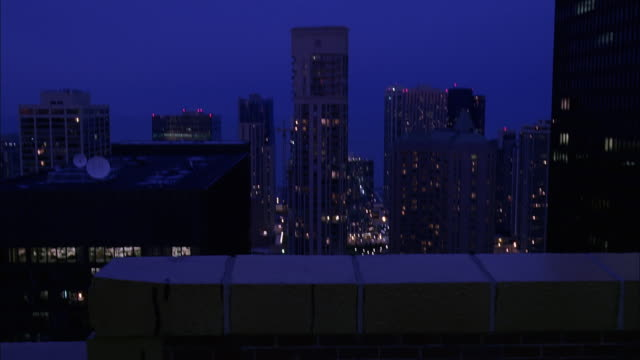 pov walking on top of high rise building and looking down at busy street intersection at dusk / chicago, illinois, usa - great lakes stock videos & royalty-free footage