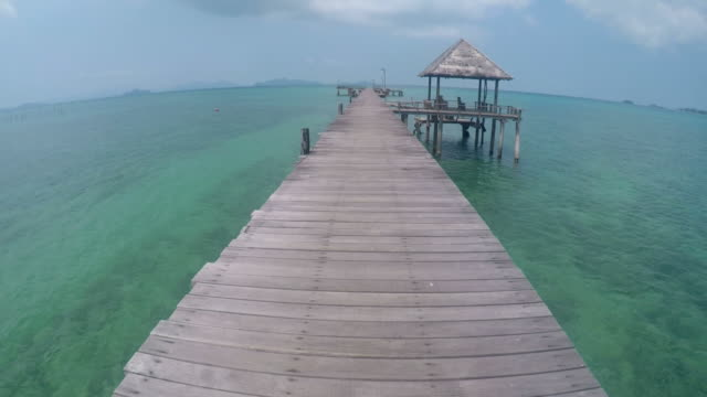 walking on wooden docks at tropical islands - molo video stock e b–roll