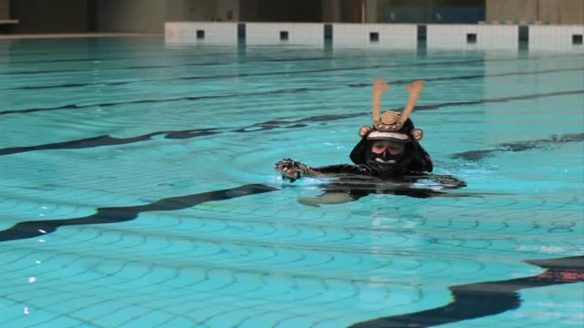 walking or running in a full suit of samurai armour is not the easiest thing in the world voiced swimming the hard way on october 05 2012 in tokyo... - suit of armour stock videos and b-roll footage