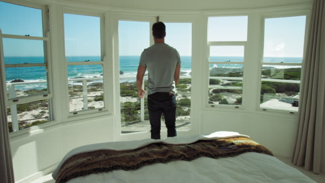 vídeos de stock e filmes b-roll de walking out and looking at view - janela aberta