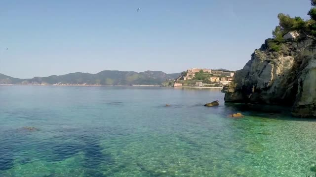 """""""walking"""" over the sea drone footage - island of elba stock videos & royalty-free footage"""