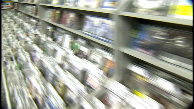 pov of walking past cd racks at tower records in los angeles california - tower records stock videos & royalty-free footage