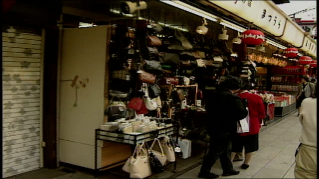 of walking past stands in street market in asakusa, japan - 1990 stock videos & royalty-free footage