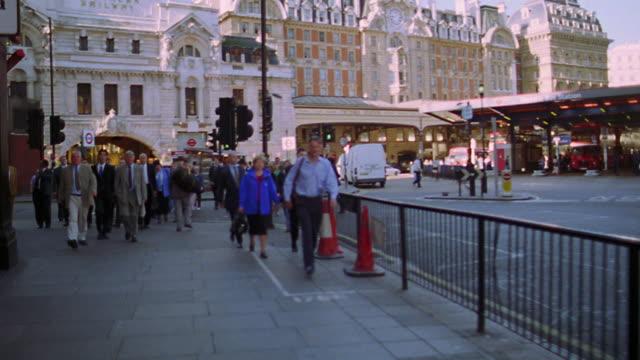 Walking point of view businesspeople walking on sidewalk / London, England