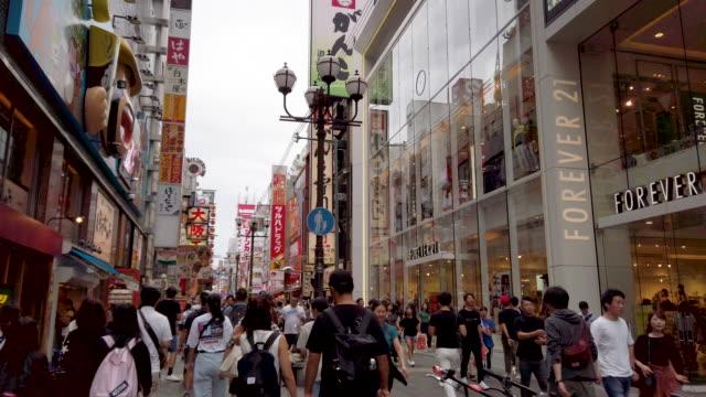 4k walking point of view. crowded people at dotonbori osaka night street in osaka , japan - walking point of view stock videos & royalty-free footage