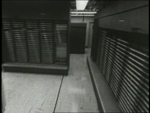 b/w 1965 walking point of view large computer room - mainframe stock videos & royalty-free footage