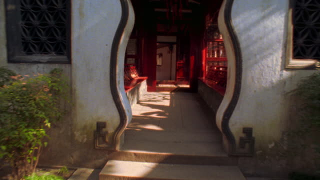 walking point of view through doorway + exterior hallway of traditional chinese building / shanghai, china - doorway stock videos & royalty-free footage